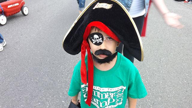 Little boy is dressed like a pirate.