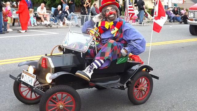 Clown driving a clown car.