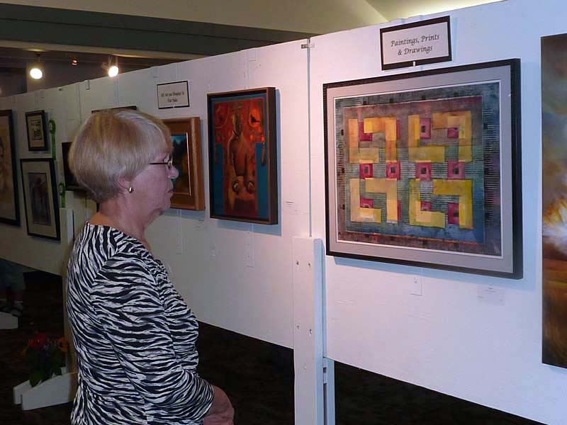 Woman observing artwork at the 2011 Arts of the Terrace Juried Art Show.
