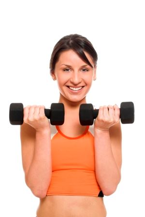 Young woman lifting hand weights with a smile