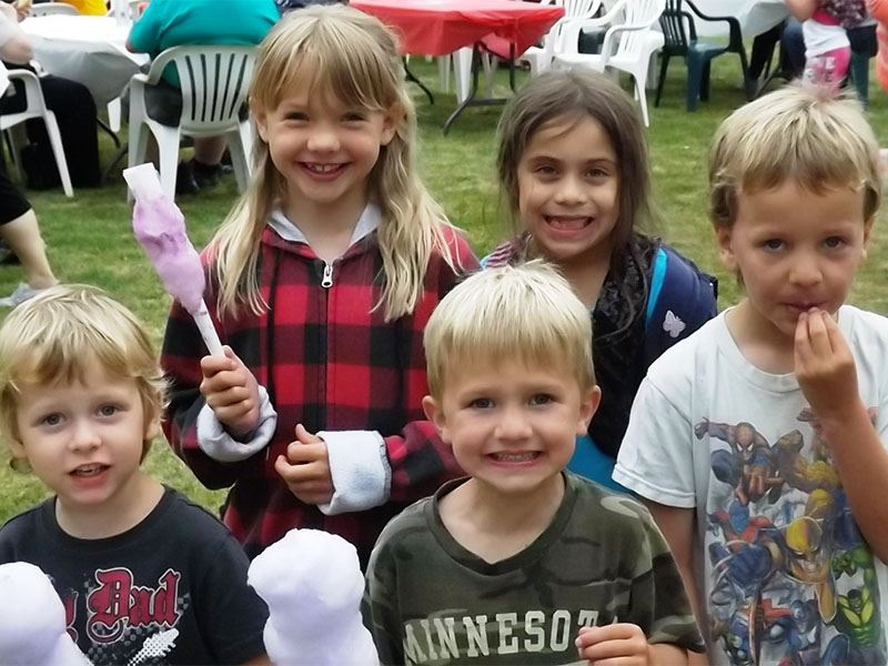 A group of kids pose with their cotton candy.