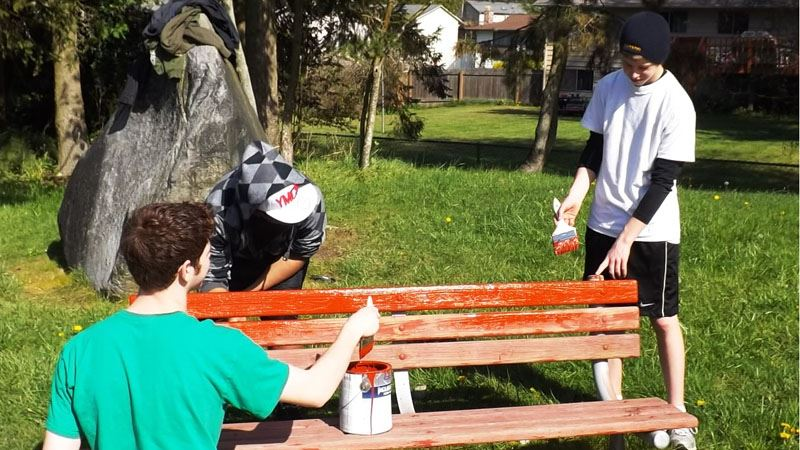 Volunteers staining bench.
