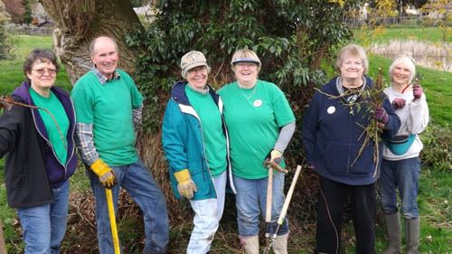 Six Garden Club volunteers under a tree