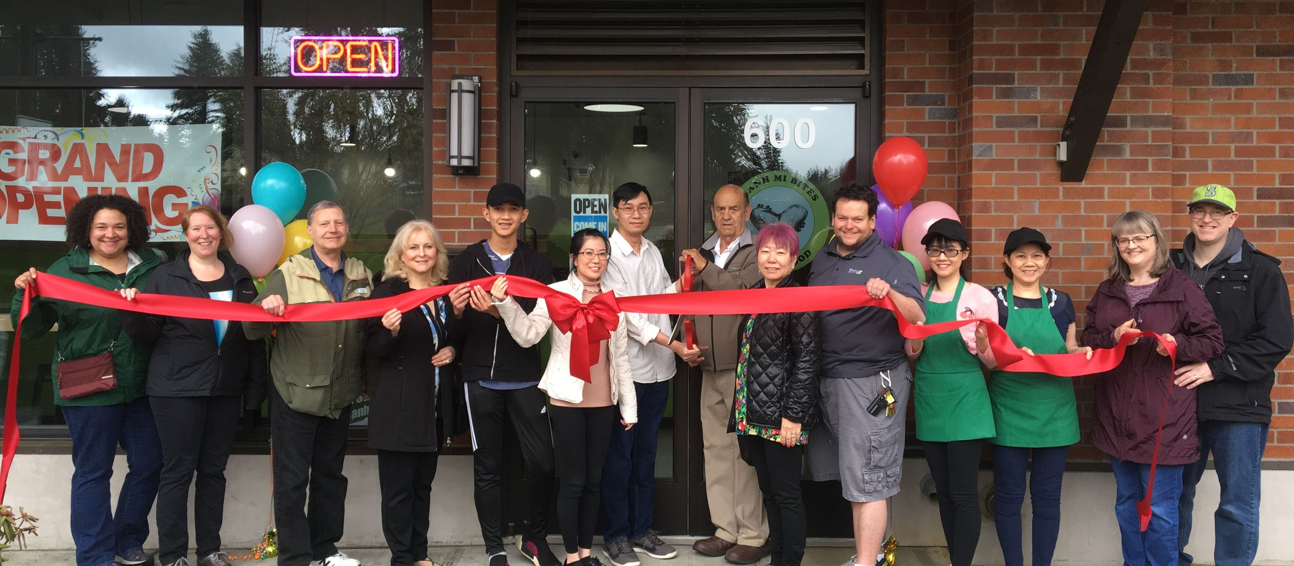 Group of employees and owners of Banh Mi Bites, April 28, 2018 opening