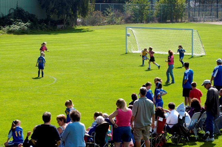 Children's soccer game on pitch at Forest Crest Playfirlend complex