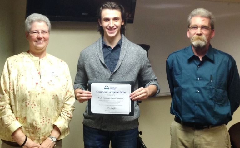 Dakota Damiano between Ken Courtmanch and Linda Rogers holding certificate