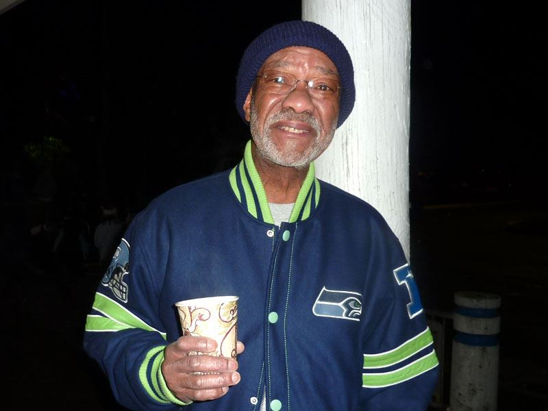 Man enjoying a warm drink at the Tree Lighting Ceremony of 2011.