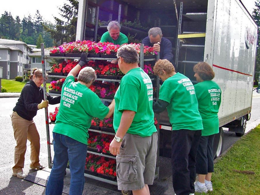 Members of the Garden Club roll flowers off the truck.