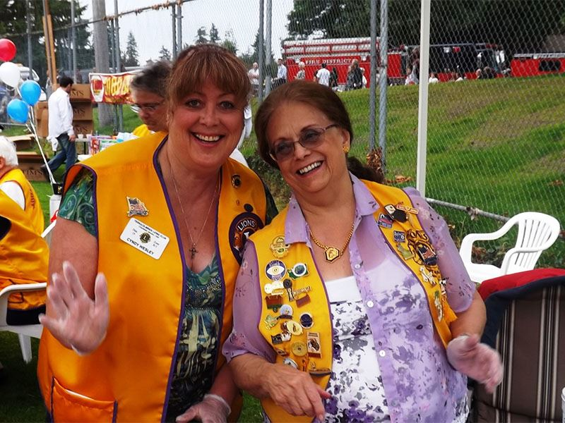 Two women pose together at 2012 National Night Out.