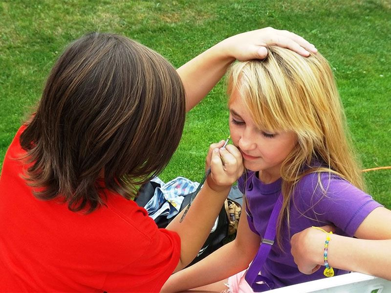 Girl getting her face painted at National Night Out 2012.